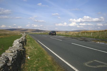 car on the road in the yorkshire dales Stock Photo - 3281250