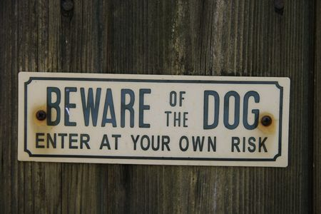 beware of the dog sign on a wooden background Banco de Imagens