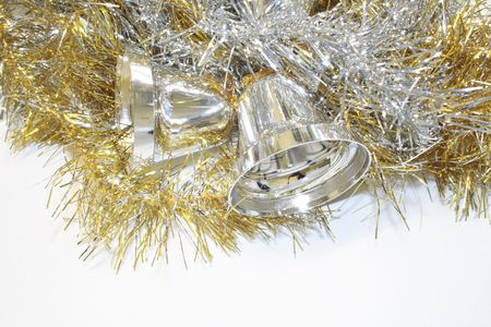 gold and silver tinsel with silver bells objects for decorating the christmas tree isolated over a white background Stock Photo - 3405437
