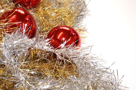 gold and silver tinsel with red baubles  objects for decoration of the christmas tree isolated over a white background Stock Photo - 3405438