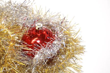 gold and silver tinsel with red baubles  objects for decoration of the christmas tree isolated over a white background Stock Photo - 3405436