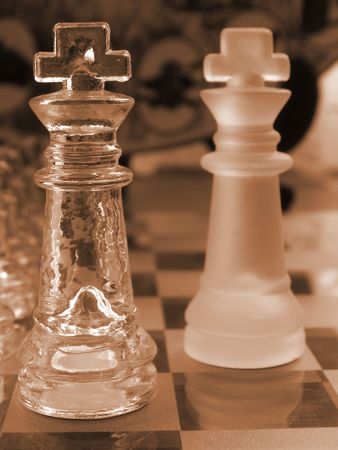 glass chess set game with a engraved glass playing board coloured sepia the clear king  is the focal point photo