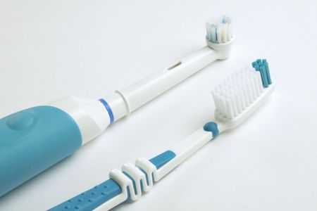 electric tooth brush challenges the normal toothbrush Stock Photo