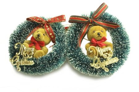 teddy wreath: teddy wreaths with merry  christmas sign on it a tree decoration over a light background