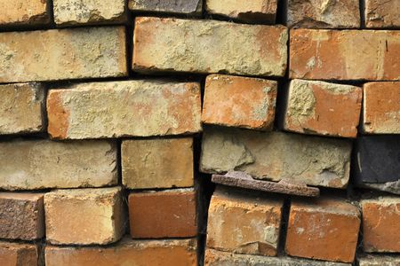 reclaimed: reclaimed bricks stacked ready to be cleaned and used for rebuilds Stock Photo