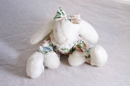 small white bunny rabbit toy dressed in a florel suit with a bow on its head Stock Photo - 3421928