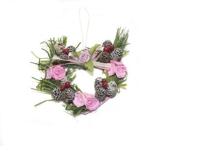 heart shaped wreath christmas tree decorations over a light background Stock Photo - 3813955