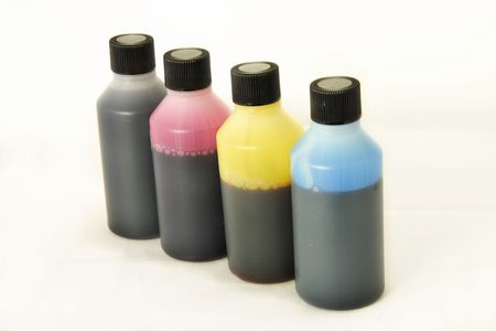 four plastic bottles with different coloured ink in each photo