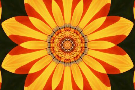kaleidascope: kaleidascope pattern of a flower in orange and yellow