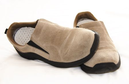 overwhite: tan suede slip-on casual shoes over a white background