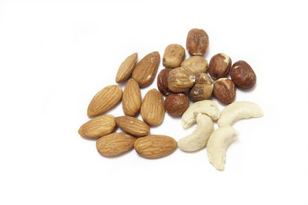 overwhite: mixed nuts of hazelnuts,cashew and almonds over white