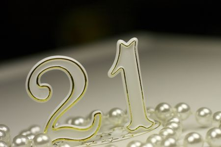 21st birthday sign surrounded by pearls, a celebratory concept Stock Photo - 5340788