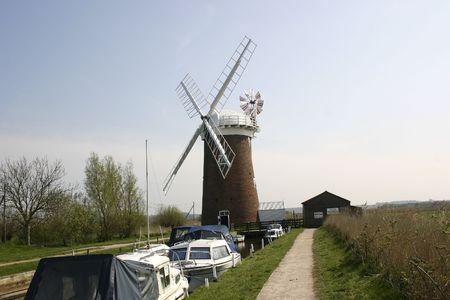 sky line: windmill and boats set against the sky line