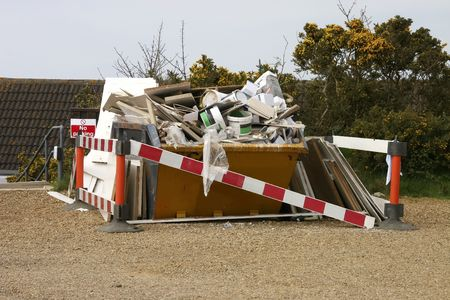 skip full of rubbish from the contract decorators