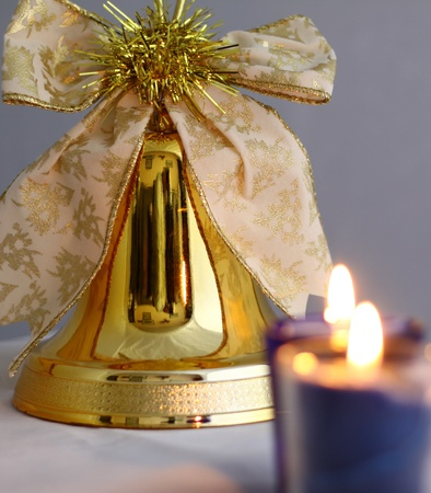 flickering: lit candles flickering around the decorative christmas bell