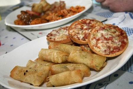 mini pizza: cooked mini pizza and mini spring rolls