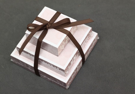 notelet: a gift of different size notelets tied with a brown ribbon Stock Photo