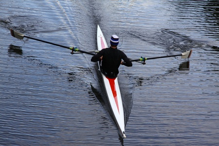 rower: a single rower practices his rowing on the river Stock Photo