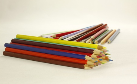 a large assortment of wooden colored crayons against a light background Stock Photo - 11028942