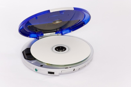 cd player: Old portable cd player with blue cover; cd inside, isolated on white background
