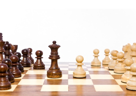 intimidation: A light colored pawn challanges the dark queen Stock Photo