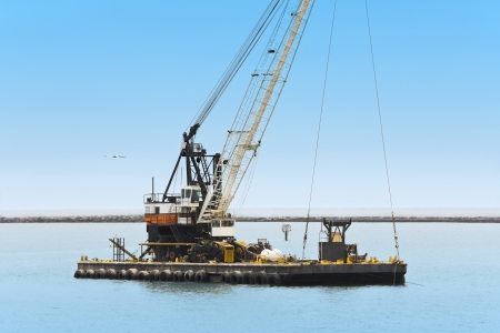 idle: A dredge sits idle in the port channel - horizontal view