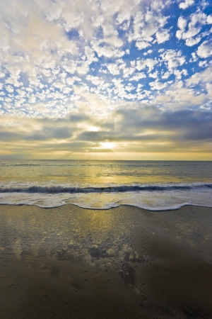 Yellow clouds and sunset off the California coastline; vertical view Stock Photo - 14088583