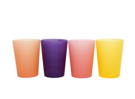 Four colorful glasses isolated on white; side view photo