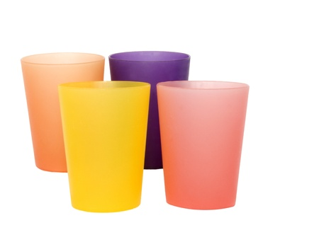 Four colorful glasses isolated on white photo