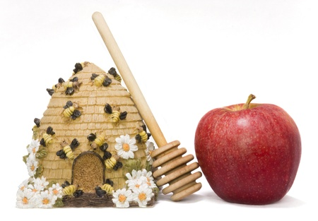 Sweet symbols of the Jewish New Year  apple, honey, honey stick and honey container photo