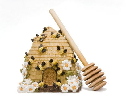 Bee hive honey container and honey stick isolated on white photo
