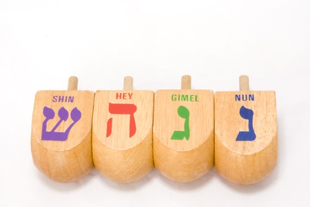 Dreidle is a traditional game for the Jewish holiday of Chanukah  Players spin the dreidle and win or lose depending on which hebrew letter appears on the top of the fallen dreidle   photo