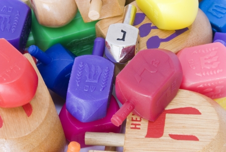 hebrew alphabet: Dreidle is a traditional game for the Jewish holiday of Chanukah  Players spin the dreidle and win or lose depending on which hebrew letter appears on the top of the fallen dreidle  Shown is an assortment of wood and plastic dreidles, and one silver color