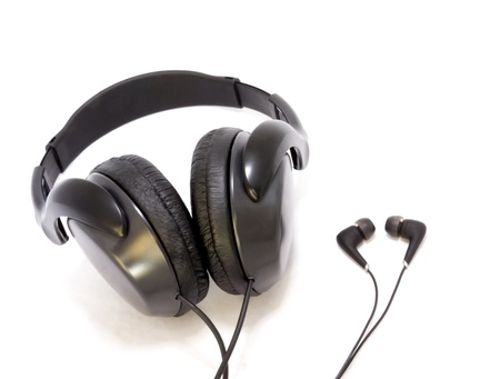 Modern large headphones and small earbuds next to each other isolated on a white background  photo