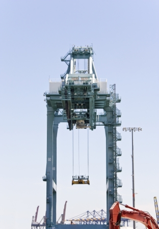 A loading crane waiting for cargo at the harbor  photo