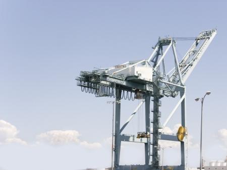 A loading crane waits for cargo  photo