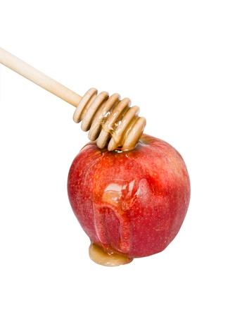 updated: S�mbolo del A�o Nuevo jud�o - la miel dulce que fluye a lo largo de un delicioso manzana roja Foto actualizada de espacio de la copia