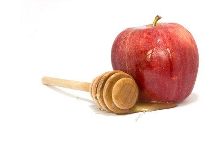tova: Symbol of the Jewish New Year - sweet honey flowing over a delicious apple  Photo updated for copy space