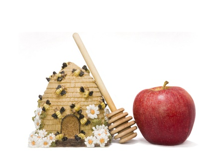 Sweet symbols of the Jewish New Year  apple, honey, honey stick and honey container photo