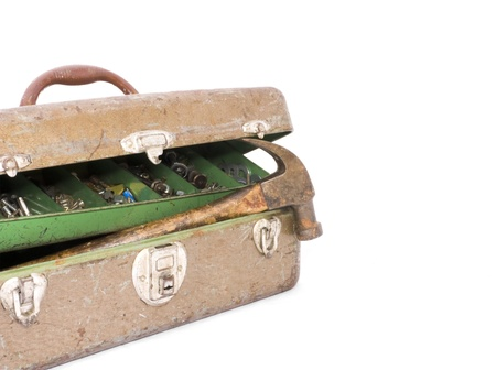rusty nail: Partly open rusty toolbox with hammer, screws, nuts, and bolts inside  Stock Photo