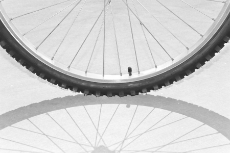 Bicycle tire and tire shadow abstract Stock Photo - 15438973