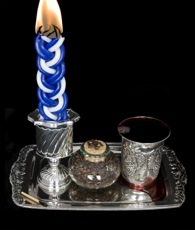 sabbath: Havdalah set  Lighted candle, spices, and kiddush cup with wine on a shiny silver tray  The havdala candle has multiple wicks and is lit after the conclusion of the Jewish sabbath; wine is served and a sweet spice is smelled