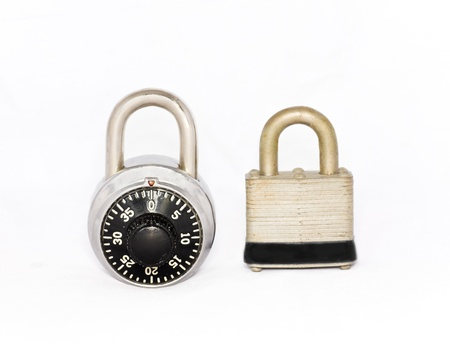 Security choices  Closed combination lock and padlock side by side isolated on a white background  Stock Photo - 15984591