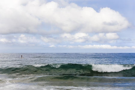 wide open spaces: Small man, big ocean  Looking out over the vast Pacific Ocean on a cloudy day as a wave rolls in