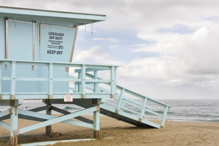 Where s the lifeguard  Closed wooden lifeguard hut overlooking the ocean on a cloudy day Stock Photo - 15984618