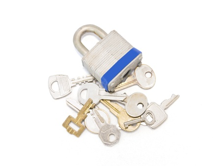 Which key opens the lock  A group of different keys beside a closed padlock Stock Photo - 15984586