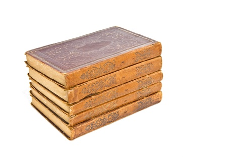 book spine: A set of old books  A group of old books stacked one upon the other, volumes numbered one through five; worn textured cover, can be paper or leather  Isolated on a white background, horizontal view  Stock Photo