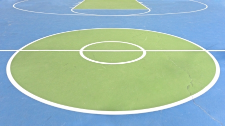 Outdoor basketball court   White lines and circles mark the various sections of a basketball court  A long crack in the painted concrete runs through the court  Stock Photo - 16848872