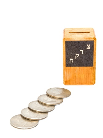 jewish group: 5 silver dollars   Photo shows 5 silver dollar coins and a small wooden tzedakah, charity box  Horizontal view, isolated on a white background