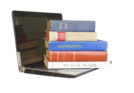 Learn with modern technology   Fast access to learn many subjects  Five books on science, math, literature, finance, and religion resting on an open black laptop, isolated on a white background   photo